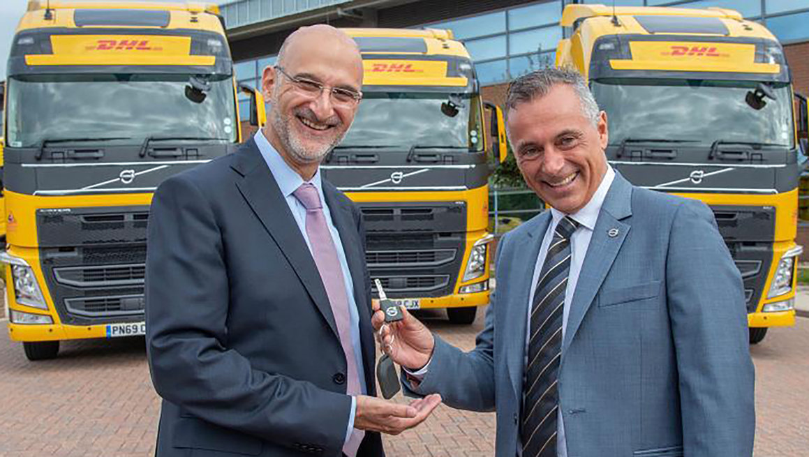 José Nava, CEO DHL Supply Chain UKI and Robert Grozdanovski, MD Volvo Trucks UK celebrate the handover of the first of 700 new Volvo vehicles.