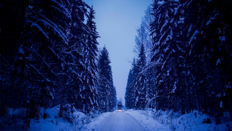 Saku Simpanens truck on an icy forest road in Finland.